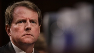 Former White House Counsel Don McGahn looks on as Judge Brett Kavanaugh appears before the Senate Judiciary Committee in September of 2018. (Drew Angerer/Getty Images)