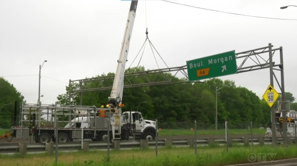 Highway 40 truck hits sign