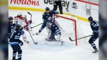 Montreal Canadiens' Brendan Gallagher (11) scores on Winnipeg Jets goaltender Connor Hellebuyck (37) during third period NHL Stanley Cup hockey action in Winnipeg, Wednesday, June 2, 2021. THE CANADIAN PRESS/John Woods