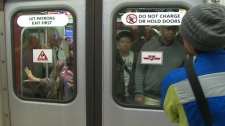 Riders wait to board a subway at the Bloor platform in Toronto, Friday, Nov. 13, 2009.
