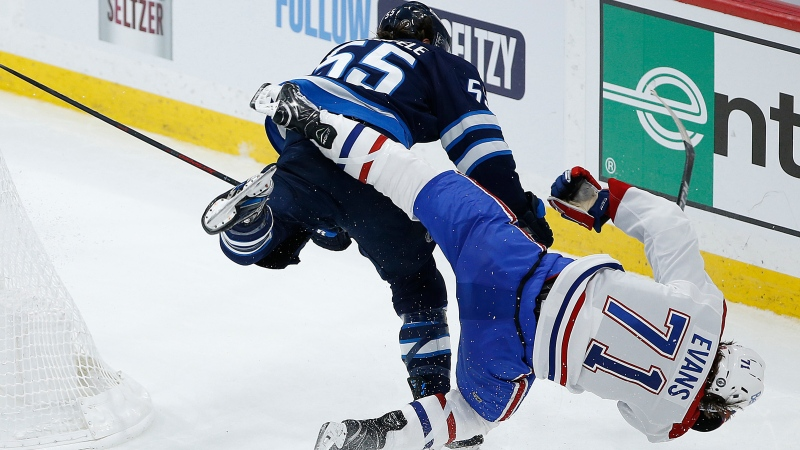 Winnipeg Jets' Mark Scheifele (55) hits Montreal Canadiens' Jake Evans (71) after he scored an empty net goal during third period NHL Stanley Cup hockey action in Winnipeg, Wednesday, June 2, 2021. The NHL's Department of Player Safety says Scheifele will have a hearing today in the aftermath of the Jets forward's crushing hit on Evans last night. THE CANADIAN PRESS/John Woods