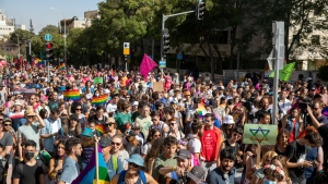 Participants march in the annual Pride parade in Jerusalem, Thursday, June 3, 2021. Thousands of people marched through the streets of Jerusalem on Thursday in the city's annual gay pride parade. (AP Photo/Ariel Schalit)