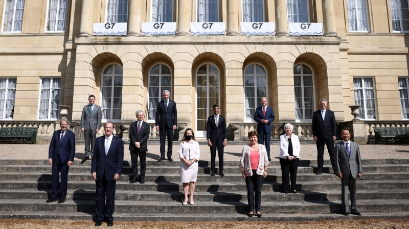 G7 finance ministers pose for a family photo as they meet at Lancaster House in London, Saturday, June 5, 2021 ahead of the G7 leaders' summit. (Henry Nicholls/Pool Photo via AP)