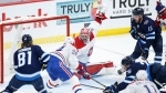 Montreal Canadiens goaltender Carey Price (31) saves the shot by Winnipeg Jets' Blake Wheeler (26) as Phillip Danault (24) defends during third period NHL playoff action in Winnipeg on Friday, June 4, 2021. THE CANADIAN PRESS/John Woods