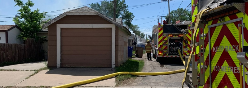 Smoke is seen rising from the site of a garage fire in the 2200 block of Wallace Street in Regina, on June 5, 2021. (Source: @Regina_Fire/Twitter)