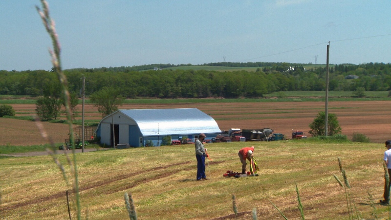 Guided by GPS, Johnathan Fowler walks through fields in Shubenacadie, N.S. with ground penetrating instruments, recording images of what lies below.
