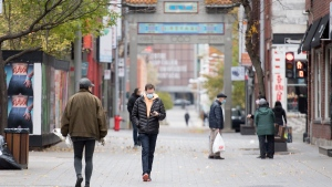 People make their way along a street in Chinatown in Montreal, Sunday, November 1, 2020, as the COVID-19 pandemic continues in Canada and around the world. A campaign called 'Fortunes for Solidarity' with the goal to fight anti-Asian racism and bring customers back to the area was launched recently in the area. THE CANADIAN PRESS/Graham Hughes