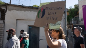 Activists take part in a protest against the forcible evictions of dozens of Palestinian families by Israeli settlers in the Sheikh Jarrah neighbourhood of east Jerusalem, Friday, June 4, 2021. (AP Photo/Maya Alleruzzo)
