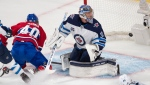 Montreal Canadiens' Joel Armia (40) scores a shorthanded goal on Winnipeg Jets goaltender Connor Hellebuyck (37) as Jets' Josh Morrissey (44) looks on during second period NHL Stanley Cup playoff hockey action in Montreal, Sunday, June 6, 2021. THE CANADIAN PRESS/Ryan Remiorz