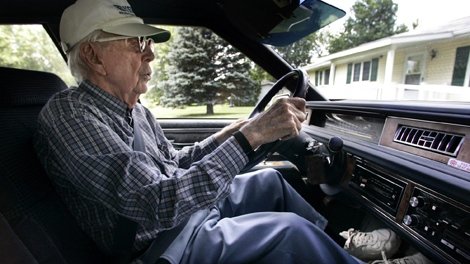 Harold Harryman, 100, drives to the Douds Community Center for the senior meal program Tuesday, June 5, 2007 in Douds, Iowa. Harryman is one of about 40 drivers 100-years-old or older that still drive in Iowa. Douds says he has been driving accident and ticket-free for almost 90 of his 100 years. And he continues to add to that streak as he joined the ranks earlier this year of the 35 people in Iowa who still have driver's licenses at age 100 or older. (The Gazette / Brian Ray)