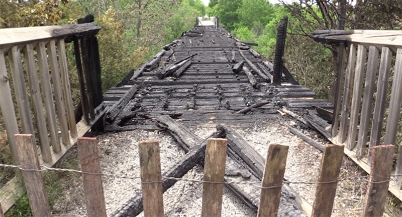A portion of the pedestrian rail bridge destroyed by fire in Paisley, Ont. is seen Monday, June 7, 2021. (Scott Miller / CTV News)