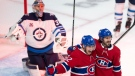 Montreal Canadiens Artturi Lehkonen (62) celebrates his goal with teammate Phillip Danault (24) as Winnipeg Jets goaltender Connor Hellebuyck (37) looks on during first period NHL Stanley Cup playoff hockey action in Montreal, Monday, June 7, 2021. THE CANADIAN PRESS/Ryan Remiorz