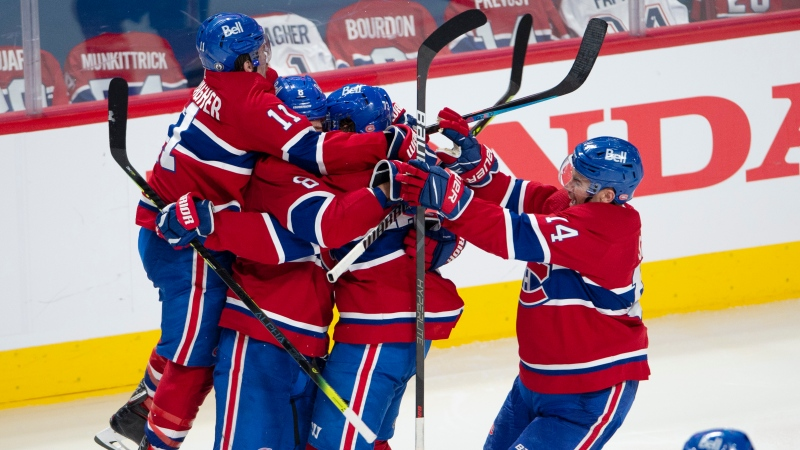 Montreal Canadiens' Tyler Toffoli celebrates with teammates after scoring the winning goal following overtime NHL Stanley Cup playoff hockey action against the Winnipeg Jets, in Montreal, Monday, June 7, 2021. THE CANADIAN PRESS/Paul Chiasson