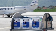 In this May 4, 2021, file photo, a container with boxes of the Pfizer vaccine for COVID-19 is delivered at the Sarajevo Airport, Bosnia. (AP Photo/Eldar Emric, File)