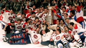 The Montreal Canadiens pose for a photograph with the Stanley Cup following their 4-1 victory over the Los Angeles Kings in Montreal in this June 9, 1993 photo. Patrick Roy front left lying down. ( CP PHOTO/Frank Gunn)