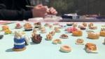 Ottawa artists StreetArtMiniature working on a mini burger among her other creations. (Dave Charbonneau / CTV News Ottawa)
