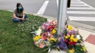 A memorial grows for victims of a crash in London, Ont., Monday, June 7, 2021. (Nick Paparella / CTV News)