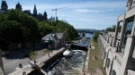 A boat waits for water to raise it as it leaves the Ottawa river and moves through the locks to enter the Rideau river Monday May 31, 2021 in Ottawa. THE CANADIAN PRESS/Adrian Wyld