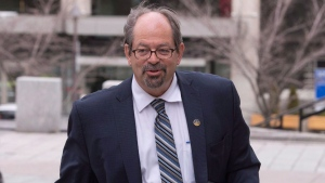 Quebec Native Affairs Minister Geoffrey Kelley walks to a cabinet meeting at the Provincial Legislature, in Quebec City on Wednesday, May 4, 2016. THE CANADIAN PRESS/Jacques Boissinot