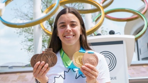 Three-time Olympic medallist Meaghan Benfeito shows off replacement copies of her three lost Olympic medals and two Pan-American Games medals in Montreal on Tuesday, June 8, 2021. The Canadian diver lost her medals along with all her belongings in a devastating fire of her condominium last winter. THE CANADIAN PRESS/Paul Chiasson