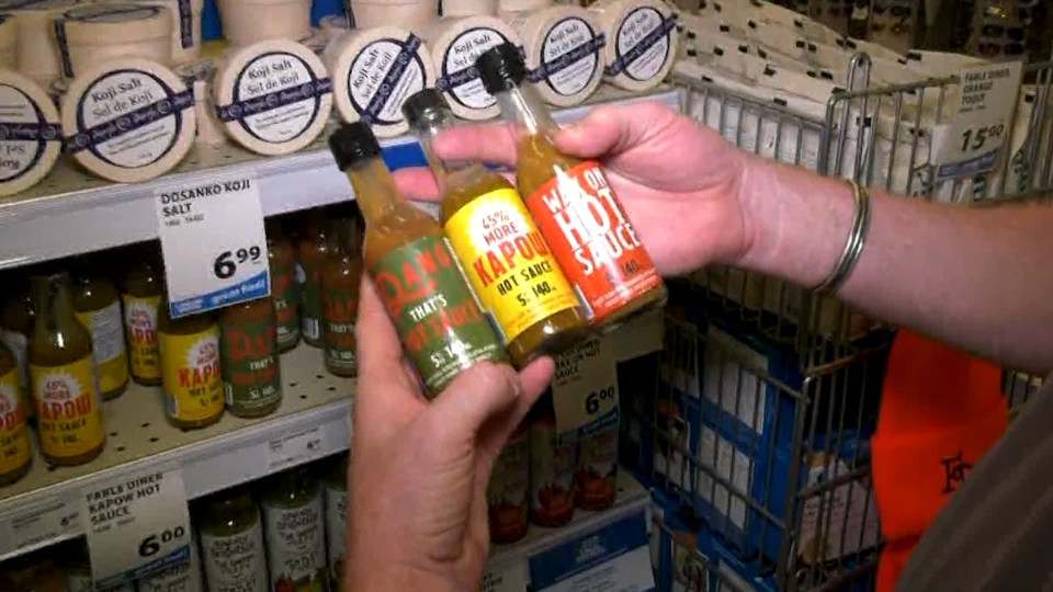 Ron Macgillivray shows off some Fable hot sauce.