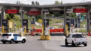 In this photo taken Sunday, May 17, 2020, a truck from Canada heads to the single open lane heading into the U.S. at the Peace Arch border crossing in Blaine, Wash. (AP / Elaine Thompson)