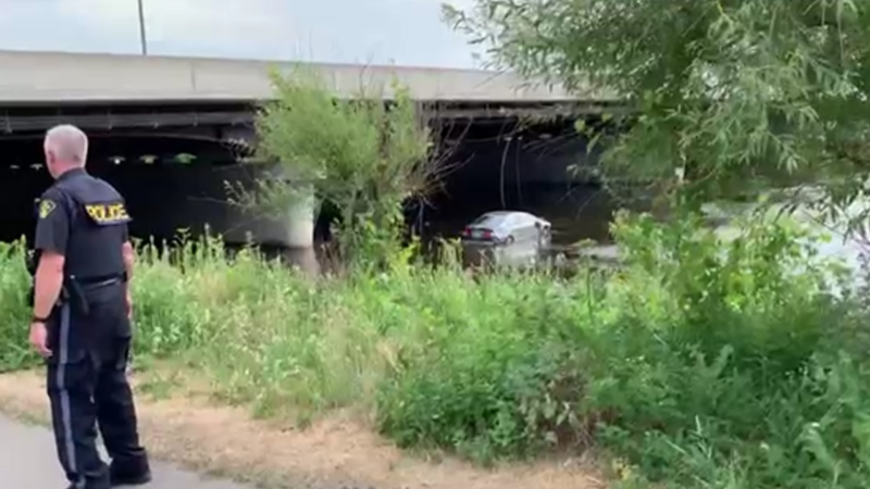 OPP at the scene of crash in which a driver drove into the Rideau River near the Vanier Parkway and Highway 417 in Ottawa, June 8, 2021. (Photo courtesy of Catherine Chapin)