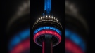 The CN Tower is shown lit up in red, white and blue in honour of the Montreal Canadiens on Tuesday night. (Twitter/@TourCNTower)