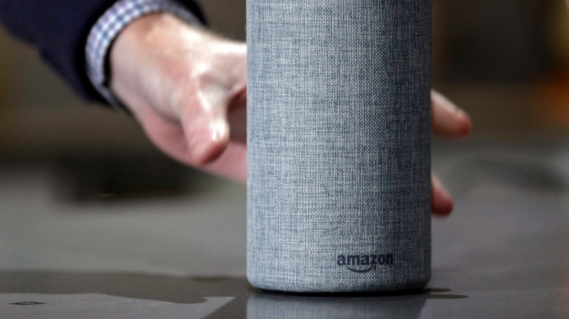 In this Sept. 27, 2017, file photo, a new Amazon Echo is displayed during a program announcing several new Amazon products by the company, in Seattle. (AP Photo/Elaine Thompson, File)