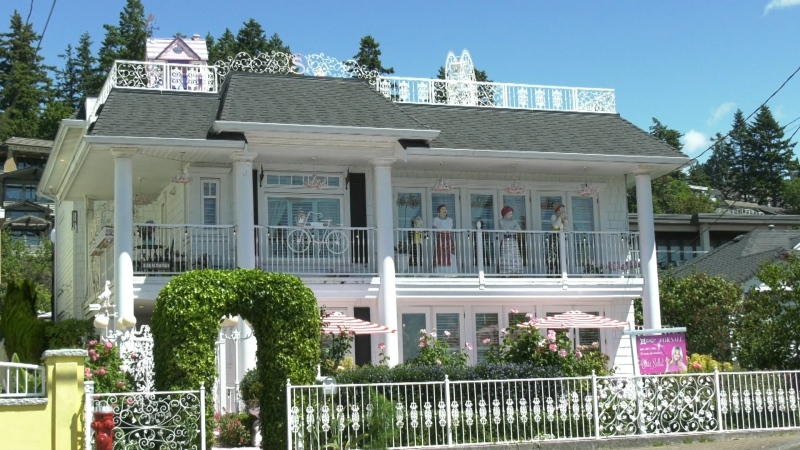 Human-scale dollhouse up for sale