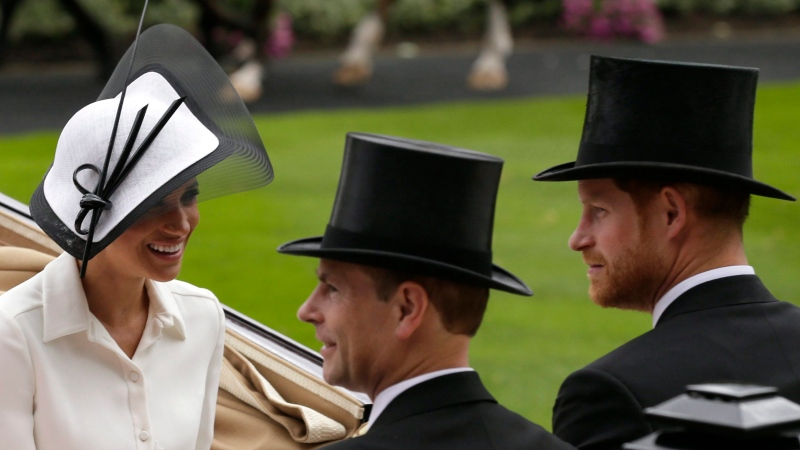 Britain's Prince Harry and Meghan, Duchess of Sussex, arrives at the parade ring with Prince Edward, Earl of Wessex, and Sophie, Countess of Wessex, in a horse drawn carriage on the first day of the Royal Ascot horse race meeting in Ascot, England, Tuesday, June 19, 2018. (AP Photo/Tim Ireland)