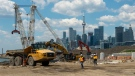 Construction crews work on the Port Lands renewal project in Toronto on Tuesday June 1, 2021. (THE CANADIAN PRESS / Frank Gunn)