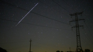 In this photo taken with a long exposure, a string of SpaceX StarLink satellites passes over Salgotarjan, Hungary, early Wednesday, May 12, 2021. (Peter Komka/MTI via AP)