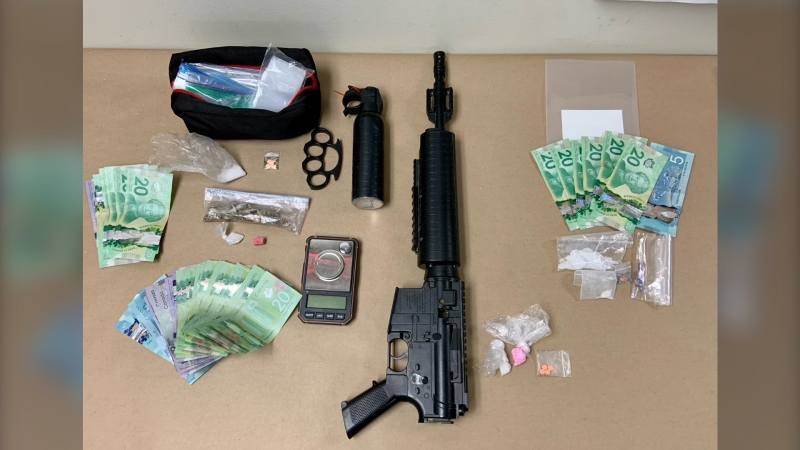 Some of the drugs, weapons and cash seized by police in Lethbridge. (Lehtbridge police handout)