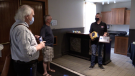 Defibrillator donation made to the Livery in Goderich, Ont. by the Dave Mounsey Memorial Fund on June 10, 2021. (Scott Miller/CTV London)