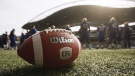 A CFL ball is photographed at the Winnipeg Blue Bomber stadium in Winnipeg Thursday, May 24, 2018. THE CANADIAN PRESS/John Woods