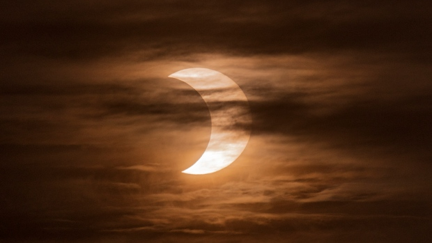 I got up early, very early, to see if I could capture the eclipse. At first it was quite cloudy and then it started clearing up. Then it started getting cloudy again. This was taken towards the latter half of the eclipse around 5:55am. (Ugur Avunca/CTV Viewer)