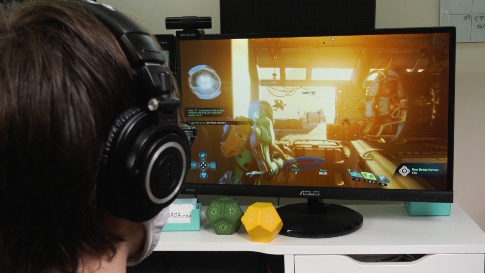 A gamer plays an Electronic Arts video game.