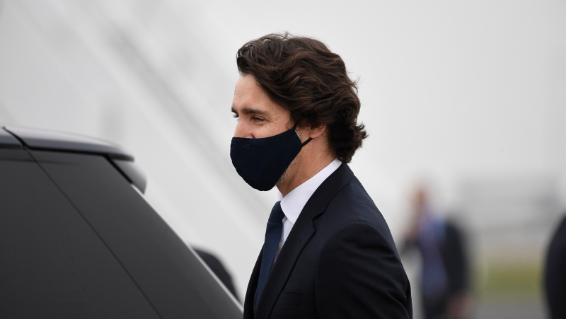 Prime Minister Justin Trudeau arrives ahead of the G7 meeting at Cornwall airport in Newquay, Cornwall, England, Thursday, June 10, 2021. (AP Photo/Alberto Pezzali, Pool)