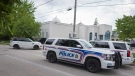 Police keep a presence outside the London Muslim Mosque in London, Ont. on Tuesday, June 8, 2021 after a hate-inspired terrorist attack on Sunday left four members of a Muslim family dead and their youngest son in hospital. THE CANADIAN PRESS/ Geoff Robins