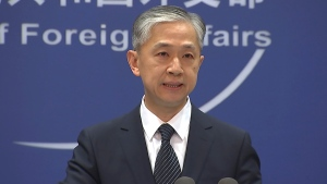 """China's Foreign Ministry spokesperson Wang Wenbin speaks during the daily briefing in Beijing on Friday, June 11, 2021. China on Friday said the U.S. and Australia were """"flexing their muscles"""" with recent naval drills in the South China Sea, underscoring Beijing's sensitivity over the strategic waterway it claims as its own. (AP Photo/Liu Zheng)"""