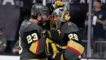 Vegas Golden Knights defenceman Alec Martinez (23) and goaltender Marc-Andre Fleury (29) celebrate after defeating the Colorado Avalanche in Game 6 of an NHL hockey Stanley Cup second-round playoff series Thursday, June 10, 2021, in Las Vegas. (AP Photo/John Locher)