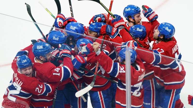 Montreal Canadiens right wing Tyler Toffoli (73) is mobbed by teammates after scoring the game-winning goal following overtime NHL Stanley Cup playoff hockey action against the Winnipeg Jets, in Montreal, Monday, June 7, 2021. THE CANADIAN PRESS/Paul Chiasson