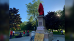 The group, Revolution of the Heart, covered the statue of the Sir John A. Macdonald statue in Kingston, Ont. on Thursday. (Kimberley Johnson/CTV News Ottawa)
