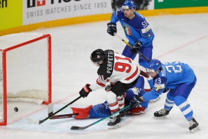 Canada's Cole Perfetti scores his side's opening goal during the Ice Hockey World Championship group B match between Italy and Canada at the Arena in Riga, Latvia, Sunday, May 30, 2021. (AP Photo/Sergei Grits)