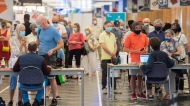 Some people eligible for a second COVID-19 vaccination shot wait in line at the Palais des congres vaccination site in Montreal, Sunday, June 6, 2021, as the COVID-19 pandemic continues in Canada and around the world. THE CANADIAN PRESS/Graham Hughes