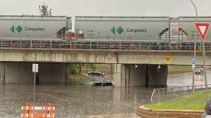A van was trapped after the Albert St. underpass flooded on June 11, 2021.