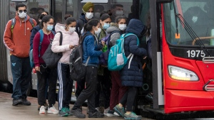 Passengers crowd on to a Brampton ZUM bus outside an Amazon Fulfillment Warehouse in Brampton, Ontario on Monday May 3, 2021. The warehouse is partially shut down due to a COVID19 outbreak. THE CANADIAN PRESS/Frank Gunn