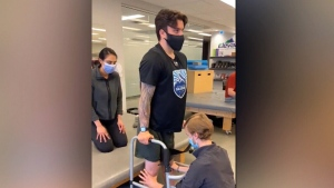 Broncos player tries out walker for first time