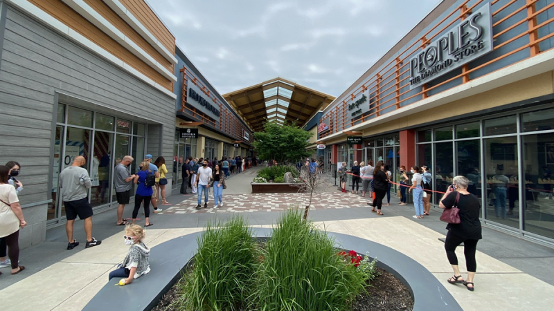 People line-up outside stores at Tanger Outlets in Ottawa on Friday, as stores reopen for the first time since April. (Jeremie Charron/CTV News Ottawa)